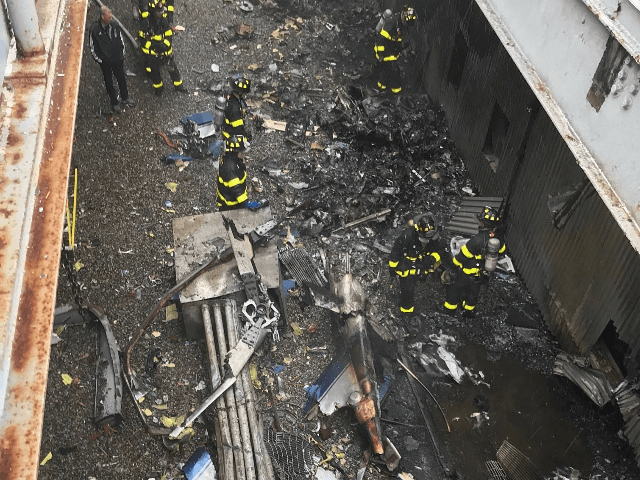 In this handout photo provided by the New York City Fire Department, firefighters work on the roof of 787 Seventh Avenue at 51st Street after a helicopter crashed there on June 10, 2019 in New York City. One person, reportedly the pilot and only person on board, was killed. (Photo …