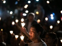 People attend a candlelight vigil at Victoria Park in Hong Kong on June 4, 2019, to mark the 30th anniversary of the 1989 Tiananmen crackdown in Beijing. - Large crowds turned out for a mass candlelight vigil in Hong Kong on June 4 evening marking 30 years since China's bloody …