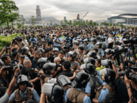 Residents argue with police officers at the Tamar Park outside the Central Government Complex on June 13, 2019 in Hong Kong China. Hong Kong's Legislative Council delayed a second reading of the controversial extradition on Thursday after police and protesters clashed outside government buildings as tensions continue over the bill …
