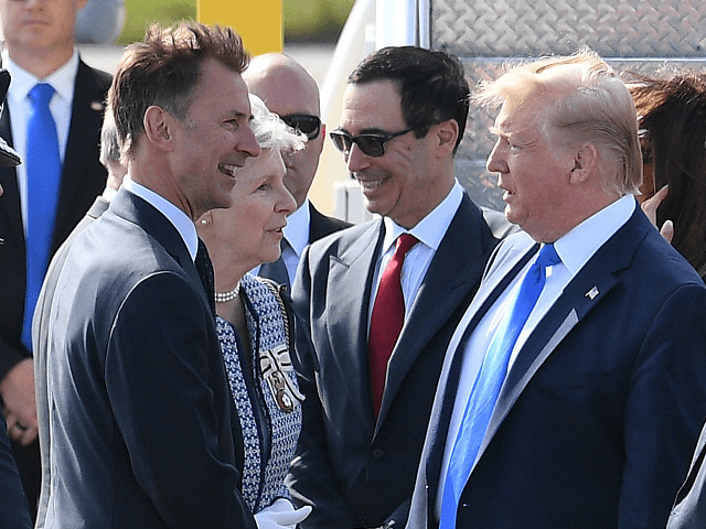 LONDON, ENGLAND - JUNE 03: Foreign Secretary Jeremy Hunt greets US President Donald Trump as he arrives at Stansted Airport on June 3, 2019 in London, England. President Trump's three-day state visit will include lunch with the Queen, and a State Banquet at Buckingham Palace, as well as business meetings …