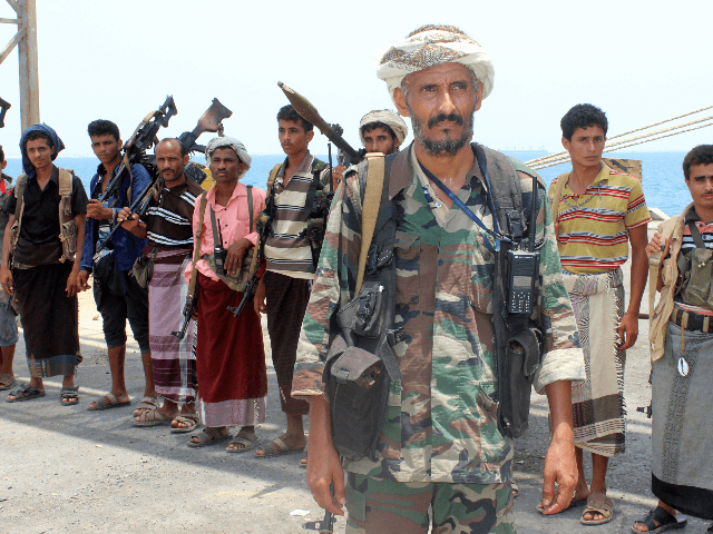 Huthi rebels stand at attention at the Saleef port on May 11, 2019, in the Red Sea port of Hodeidah, ahead of their withdrawal. - A senior pro-government official in Yemen accused Huthi rebels of faking an announced pullout Saturday from three Red Sea ports, as a UN source said …