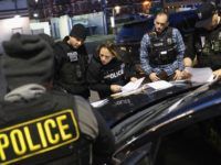 "NEW YORK, NY - APRIL 11: U.S. Immigration and Customs Enforcement (ICE), officers prepare for morning raids to arrest undocumented immigrants on April 11, 2018 in New York City. ICE detentions are frequently controversial in New York, considered a ""sanctuary city"" for undocumented immigrants, and ICE receives little or no …"