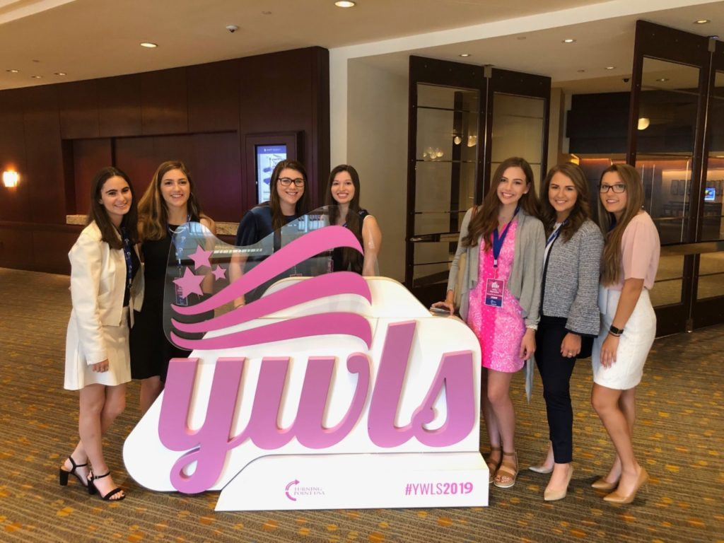 TPUSA attendees pose with event sign