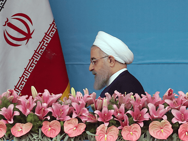 "Iranian President Hassan Rouhani (L) arrives to attend a ceremony marking the country's annual army day in Tehran, on April 18, 2019. - Iran's President Hassan Rouhani called on Middle East states on April 18 to ""drive back Zionism"", in an Army Day tirade against the Islamic republic's archfoe Israel. …"