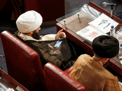 A picture taken on March 13, 2018 shows a member of Iran's Assembly of Experts using his phone while attending a session in the capital Tehran. / AFP PHOTO / ATTA KENARE (Photo credit should read ATTA KENARE/AFP/Getty Images)