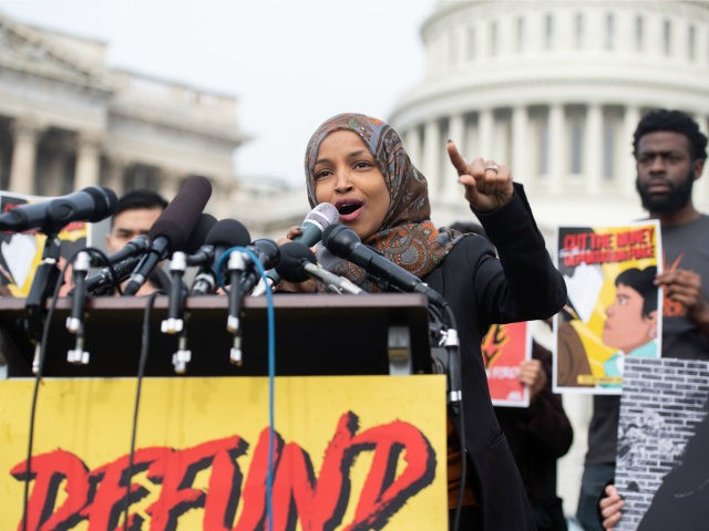 US Representative Ilhan Omar, Democrat of Minnesota, speaks during a press conference calling on Congress to cut funding for US Immigration and Customs Enforcement (ICE) and to defund border detention facilities, outside the US Capitol in Washington, DC, February 7, 2019. (Photo by SAUL LOEB / AFP) (Photo credit should …
