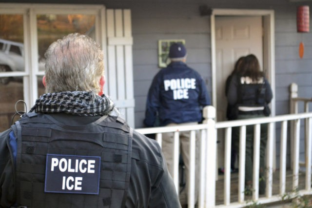 In this Feb. 9, 2017, photo provided U.S. Immigration and Customs Enforcement, ICE agents at a home in Atlanta, during a targeted enforcement operation aimed at immigration fugitives, re-entrants and at-large criminal aliens. The Homeland Security Department said Feb. 13, that 680 people were arrested in roundups last week targeting …