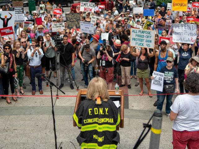 "NEW YORK, NY - JUNE 15: (EDITORS NOTE: Image contains profanity.) U.S. Rep. Carolyn Maloney (D-NY) speaks at a protest calling for the impeachment of U.S. President Donald Trump on June 15, 2019 in New York City. Major cities across the country are expected to hold ""#ImpeachTrump Day of Action"" …"