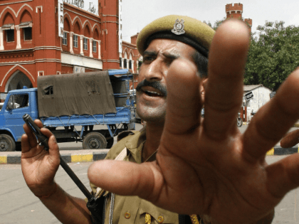 An Indian policeman gestures as he patrols the forecourt at Old Delhi Railway Station in New Delhi, 14 August 2007. India has deployed aircraft, combat troops and tens of thousands of security forces on the eve of its 60th anniversary of independence after new threats by Al-Qaeda and separatist rebels, …