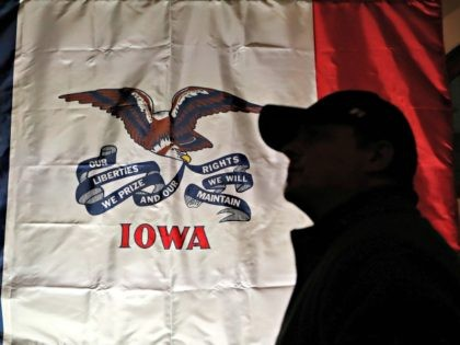 An audience member arrives at a rally for 2020 Democratic presidential candidate Sen. Bernie Sanders, Friday, March 8, 2019, at the University of Iowa in Iowa City, Iowa. (AP Photo/Charlie Neibergall)