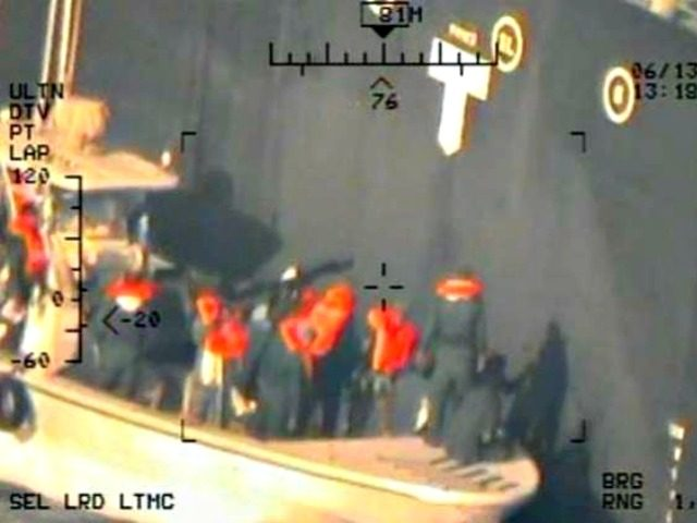 A U.S. military image released by the Pentagon in Washington on Monday that it says was taken from a U.S. Navy MH-60R helicopter in the Gulf of Oman in waters between Gulf Arab states and Iran on June 13, shows personnel that the Pentagon says are members of the Islamic …