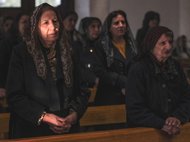 Christian worshippers attend Christmas morning mass at the Mar Addai Chaldean Church in the predominantly Iraqi Christian town of Qaraqosh, in Niniveh province some 30 kilometres from Mosul, on December 25, 2018. (Photo by AHMAD AL-RUBAYE / AFP) (Photo credit should read AHMAD AL-RUBAYE/AFP/Getty Images)