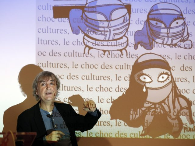 French cartoonist Plantu participates on February 11, 2015 in a workshop with students at the Paul Bert junior high school in the Paris suburb of Malakoff. AFP PHOTO / FRANCOIS GUILLOT (Photo credit should read FRANCOIS GUILLOT/AFP/Getty Images)