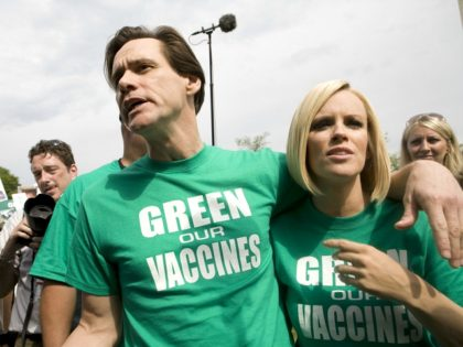 WASHINGTON - JUNE 4: Actor Jim Carrey and actress Jenny McCarthy speak with reporters before a march calling for healthier vaccines June 4, 2008 in Washington, DC. Many at the march are concerned about the connection between heavy metals in vaccines and autism. (Photo by Brendan Hoffman/Getty Images)