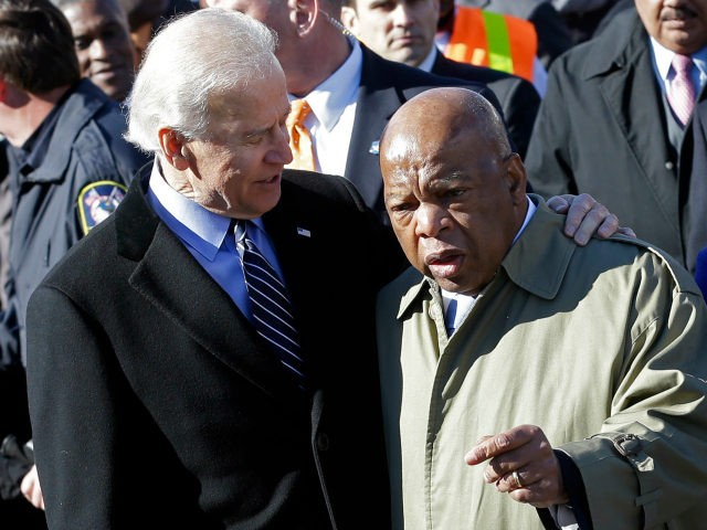 Vice President Joe Biden embraces U.S. Rep. John Lewis, D-Ga., as they prepare to lead a group across the Edmund Pettus Bridge in Selma, Ala., Sunday, March 3, 2013. They were commemorating the 48th anniversary of Bloody Sunday, when police officers beat marchers when they crossed the bridge on a …