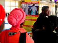 Travellers at the arrival terminal head to be screened by port health service, at the Jommo Kenyatta International airport in Nairobi on June 17, 2019. - Kenya sought to reassure the public and foreign visitors on Monday after a suspected Ebola case, which turned out to be negative, was detected …