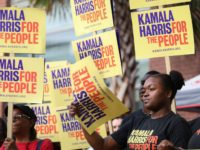 Kamala Harris supporters amongst South Carolina Democratic Party Convention attendees line up outside of the Metropolitan Convention Center in Columbia, SC on June 22, 2019. - Many of the Democratic candidates running for president are in Columbia to make appearances at the South Carolina Democratic Party Convention and the Planned …