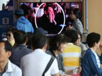 People watch a TV screen showing an image of senior North Korean official Kim Yong Chol in a musical performance by the wives of Korean People's Army officers in North Korea during a news program at the Seoul Railway Station in Seoul, South Korea, Monday, June 3, 2019. A senior …