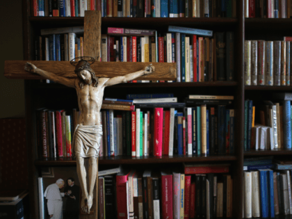 A crucifx leans against religious academic books at Oscott College on May 8, 2014 in Birmingham, England. St. Mary's College, Oscott opened in 1794 and was designed by the gothic architect Augustus Welby Pugin. The formation for catholic priesthood takes six years living in the college of seminarians dedicated to …