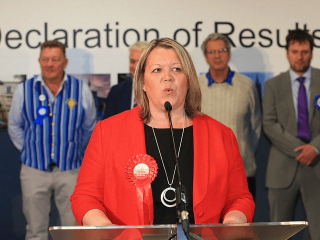 Lisa Forbes of the Labour Party accepts her win for the local seat after all votes are in and counted at the Kingsgate Conference Centre in Peterborough, England on June 6, 2019. - A local by-election was triggered when Peterborough's former MP Fiona Onasanya was sacked by her constituents in …