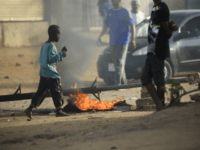 Locals set tyres on fire and block a sidestreet leading to their neighbourhood in the Sudanese capital Khartoum to stop military vehicles from driving through the area on June 4, 2019. - Sudan's protest movement called the same day for fresh rallies and rejected the military rulers' election plan after …