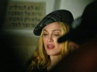 JERUSALEM, ISRAEL - SEPTEMBER 18: Singer Madonna, a self-proclaimed afficionado of Jewish mysticism, visits Cabbalist Rabbi Ashlag's tomb in Jerusalem cemetery September 19, 2004 in Jerusalem, Israel. (Photo by Pedro Ugarte-Pool/Getty Images)