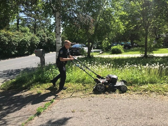 Officer Matt Siltala of the Orono Police Department went to an elderly woman's home to see how she was doing and noticed her yard was in disarray. He then mowed her lawn for her.