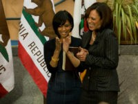 Kamala Harris, right, is inaugurated as attorney general as her sister, Maya Harris, center, and Chief Justice of California Tani Cantil-Sakauye, left, applaud at the California Museum for History, Women and the Arts in Sacramento on Monday, Jan. 3, 2011. She told hundreds of supporters that she will be tough …
