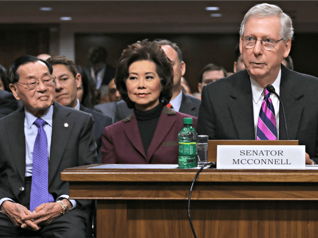 WASHINGTON, DC - JANUARY 11: Senate Majority Leader Mitch McConnell (R-KY) (R) testifies before the Senate Commerce, Science and Transportation Committee on behalf of his wife Elaine Chao (C) during her confirmation hearing to be the next U.S. secretary of transportation as her father Dr. James Chao (L) looks on …