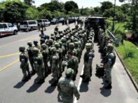Military Police form up on the highway, in Metapa, Chiapas state Mexico, Wednesday, June 5, 2019. A law enforcement group of police officers, Marines, Military Police and immigration officials arrived at the area to intercept a caravan of migrants that had earlier crossed the Mexico – Guatemala border. (AP Photo/Marco …