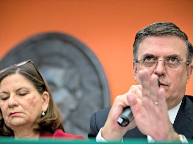 Mexican Foreign Affairs Secretary Marcelo Ebrard, right, accompanied by Mexican Ambassador Martha Barcena Coqui, speaks during a news conference at the Mexican Embassy in Washington, Monday, June 3, 2019, as part of a Mexican delegation in Washington for talks following trade tariff threats from the Trump Administration. (AP Photo/Andrew Harnik)