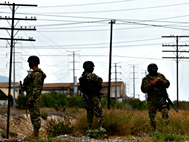 Three members of the Mexican army keep watch in the residential Anahuac neighborhood in Monterrey, Nuevo León state, Mexico on Feb. 5, 2012, after clashes between a group of gunmen and Mexican army. Photo: Julio Cesar Aguilar/AFP/Getty Images