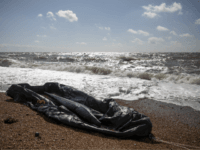 DOVER, ENGLAND - APRIL 04: An inflatable rib lies in the surf near Samphire Hoe on April 4, 2019 in Dover, England. Two separate incidents of migrants coming ashore have been reported along the Kent coast near Folkestone this morning. (Photo by Dan Kitwood/Getty Images)