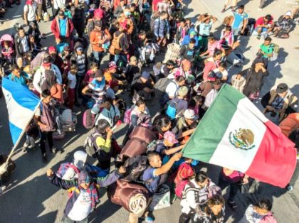 Central American migrants arrive in Tijuana, Mexico, on Thursday. (Guillermo Arias / AFP / Getty Images)