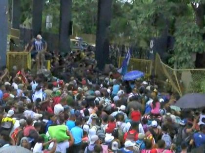 Migrants Tear Down MexicoGuatemala Border