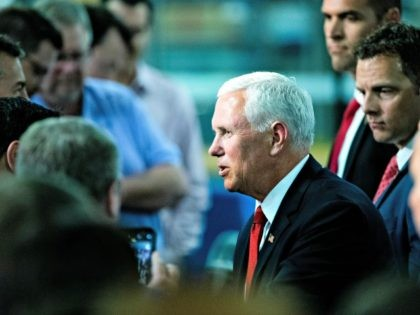 Vice President Mike Pence meets with people at JLS Automation in York, Pa., Thursday, June 6, 2019. (AP Photo/Matt Rourke)