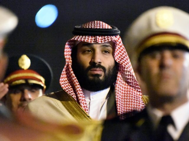 Saudi Crown Prince Mohammed bin Salman is seen behind a military band upon his arrival at Algiers International Airport, southeast of the capital Algiers on December 2, 2018. (Photo by RYAD KRAMDI / AFP) (Photo credit should read RYAD KRAMDI/AFP/Getty Images)