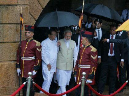 Indian Prime Minister Narendra Modi, center is received by the Sri Lankan President Maithripala Sirisena, center left, upon his arrival at the presidential secretariat in Colombo, Sri Lanka, Sunday, June 9, 2019. Modi arrived in Sri Lanka on Sunday for a brief visit as part of his first overseas tour …