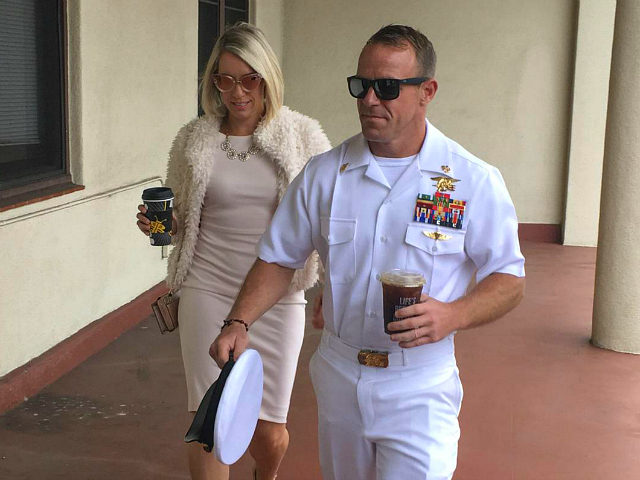 Navy Special Operations Chief Edward Gallagher, right, walks with his wife, Andrea Gallagher as they arrive to military court on Naval Base San Diego, Monday, June 24, 2019, in San Diego. Trial continues in the court-martial of the decorated Navy SEAL, who is accused of stabbing to death a wounded …