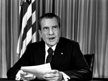 President Nixon sits in his White House office, August 16, 1973, as he poses for pictures after delivering a nationwide television address dealing with Watergate. Nixon repeated that he had no prior knowledge of the Watergate break-in and was not aware of any cover-up. (AP Photo/stf)