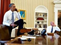 In this official White House photograph, President Barack Obama talks on the phone with Speaker of the House Boehner as Vice President Joe Biden listens in the Oval Office of the White House Aug. 31, 2013 in Washington.