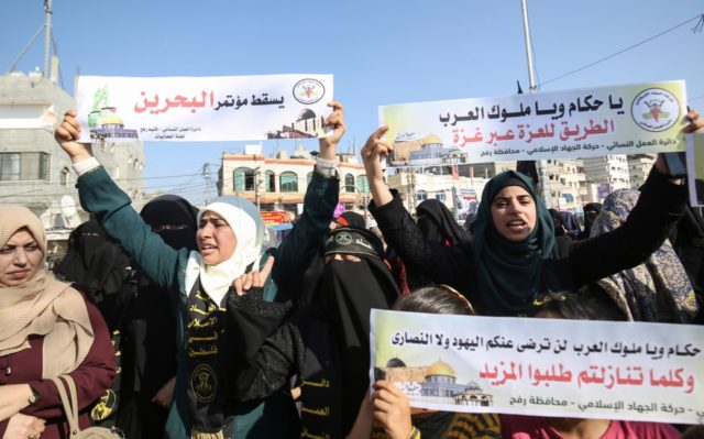 Palestinian female supporters of the Islamic Jihad protest against the Bahrain economic workshop in the southern Gaza Strip town of Rafah on June 18, 2019. - Israel will attend an upcoming conference on the economic aspects of Washington's peace plan aimed at resolving the Israeli-Palestinian conflict, Foreign Minister Israel Katz …