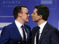Chasten Glezman Buttigieg (L) kisses his husband, South Bend, Indiana Mayor Pete Buttigieg, after he delivered a keynote address at the Human Rights Campaign's (HRC) 14th annual Las Vegas Gala at Caesars Palace on May 11, 2019 in Las Vegas, Nevada. Buttigieg is the first openly gay candidate to run …