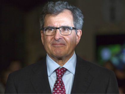 """US producer Peter Chernin poses for pictures on the red carpet upon arrival for the world premier of """"Exodus: God and Kings"""" in London on December 3, 2014. AFP PHOTO/JUSTIN TALLIS (Photo credit should read JUSTIN TALLIS/AFP/Getty Images)"""