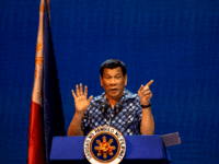 Philippine President Rodrigo Duterte gestures during the Partido Demokratiko Pilipino-LakasBayan (PDP-LABAN) meeting in Manila on May 11, 2019 ahead of the mid-term elections on May 13. (Photo by Noel CELIS / AFP) (Photo credit should read NOEL CELIS/AFP/Getty Images)