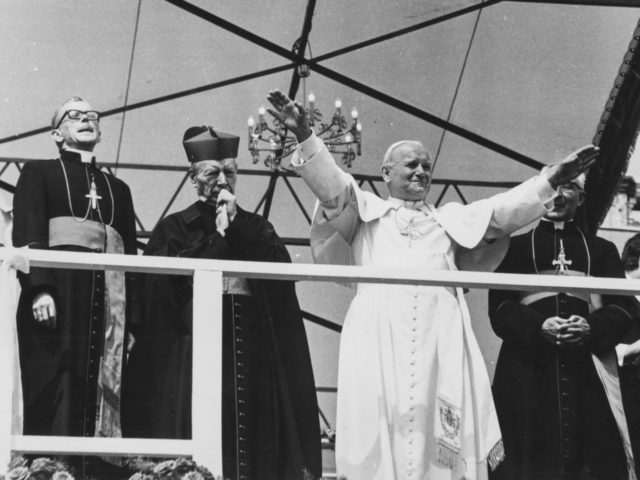 Pope John Paul II waving to the crowd gathered in front of the Jasna Gora Monastery, during his visit to Poland, June 1979. (Photo by Keystone/Hulton Archive/Getty Images)