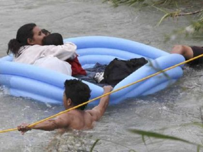 Three migrant rafts approach the U.S. bank of the Rio Grande after illegally crossing from Mexico. (Photo Bob Owen/San Antonio Express-News via AP)