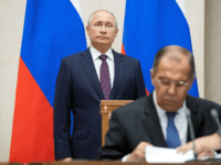 Russian Foreign Minister Sergei Lavrov (R) signs documents as Russian President Vladimir Putin attends a signing ceremony following his talks with Egyptian President in Sochi on October 17, 2018. (Photo by Pavel Golovkin / POOL / AFP) (Photo credit should read PAVEL GOLOVKIN/AFP/Getty Images)