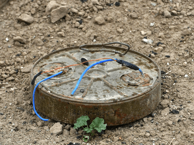 "This picture taken on March 24, 2019 shows a discarded landmine lying on the ground in the village of Baghouz in Syria's eastern Deir Ezzor province near the Iraqi border, a day after IS group's ""caliphate"" was declared defeated by the US-backed Kurdish-led Syrian Democratic Forces (SDF). (Photo by GIUSEPPE …"