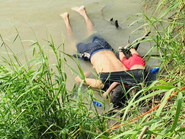 Mexican authorities find bodies of Salvadoran man and his daughter on the southern bank of the Rio Grande. (AP Photo: Julia Le Duc)